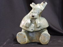 "The Original Bear Hug<br/>The Original Bear Hug<br/>8""Lx11""H<br/>Soapstone<br/>$1800.00"